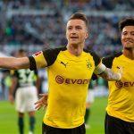Dortmund tái lập khoảng cách bốn điểm với Bayern